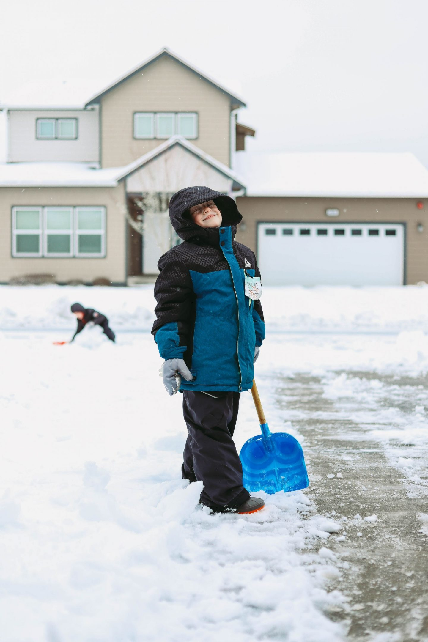 kids shoveling snow